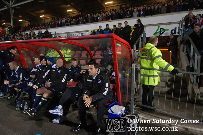 Wrexham 1 Brighton & Hove Albion 1, 18/01/2012. Racecourse Ground, FA Cup 3rd Round Replay. Visiting manager Gus Poyet (centre) taking his place in the dugout at the Racecourse Ground, before Wrexham hosted Brighton and Hove Albion in an FA Cup third round replay, played following the teams one-all draw in the first match. The replay was won by Brighton, 5-4 on penalty kicks after the match had ended in a one-all draw after extra time, watch by a crowd of 8316. The visitors played in the Championship, three leagues above their rivals from Wales, who were top of the Conference at the time of the match. Photo by Colin McPherson.