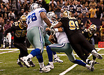 December 2009: New Orleans Saints defensive end Will Smith (91) sacks Dallas Cowboys quarterback Tony Romo (9) during an NFL football game at the Louisiana Superdome in New Orleans.  The Cowboys defeated the Saints 24-17.