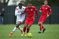 Bagasan Graham of Romford and Wyan Reid of Aveley during Romford vs Aveley, Pitching In Ishmian League North Division Football at Mayesbrook Park on 26th September 2020