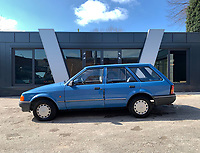 BNPS.co.uk (01202 558833)<br /> Pic: HampsonAuctions/BNPS<br /> <br /> Pictured: 1986 Ford Escort 1.3 L Estate.<br /> <br /> Since the 1990s, Geoff Barlow, 46, has collected dozens of classic cars from an Escort Mexico replica to several types of Transit, Cortina, and Sierra.<br /> <br /> However, he still regrets selling the first car which inspired his passion, a 1980 Escort Mark 2 he bought from his sister in 1992.  <br /> <br /> Geoff's fascination with Fords gathered pace in the last decade and he 'lost control,' buying as many Fords as he came across and saving them from disrepair.