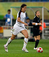 Shannon Boxx. The USWNT defeated New Zealand, 4-0, during the 2008 Beijing Olympics in Shenyang, China.  With the win, the USWNT won group G and advanced to the semifinals.
