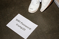 "A sign lays on the press riser with the wifi password ""trump20"" before Donald Trump, Jr., the son of US president Donald Trump, speaks at a 'Make America Great Again!' campaign rally at DoubleTree by Hilton MHT in Manchester, New Hampshire, on Thu., Oct. 29, 2020. The event took place five days before the Nov. 3 presidential election."