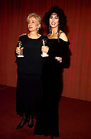 Olympia Dukakis And Cher at the 1988 Golden Globe Awards with her Best Actress award Credit: Ralph Dominguez/MediaPunch