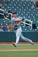 Pensacola Blue Wahoos third baseman Brian Schales (14) makes a throw to first base against the Birmingham Barons at Regions Field on July 7, 2019 in Birmingham, Alabama. The Barons defeated the Blue Wahoos 6-5 in 10 innings. (Brian Westerholt/Four Seam Images)