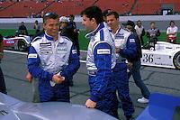 Jan Lammers (L) talks with teammate Tony Stewart on the grid. #2 Crawford..2002 Rolex 24 at Daytona, Daytona International Speedway, Daytona Beach, Florida USA Feb. 2002.(Sports Car Racing)