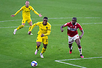 3rd October 2020; Riverside Stadium, Middlesbrough, Cleveland, England; English Football League Championship Football, Middlesbrough versus Barnsley; Victor Adeboyejo of Barnsley FC spins past Anfernee Dijksteel of Middlesbrough FC