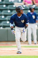 Odubel Herrera #24 of the Myrtle Beach Pelicans hustles down the first base line against the Winston-Salem Dash at BB&T Ballpark on July 5, 2012 in Winston-Salem, North Carolina.  The Dash defeated the Pelicans 12-5.  (Brian Westerholt/Four Seam Images)