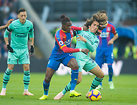 Crystal Palace Wilfried Zaha and Arsenal's Matteo Guendouzi during the Premier League match between Crystal Palace and Arsenal at Selhurst Park, London, England on 28 October 2018. Photo by Andrew Aleksiejczuk / PRiME Media Images.