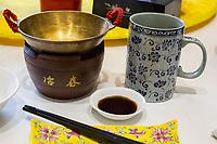 Yangzhou, Jiangsu, China.  Ye Chun Tea House Breakfast Setting:  Food Bowl, Tea Cup, Chopsticks, Soy Sauce.