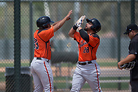 San Francisco Giants Orange first baseman Robinson Medrano (28) high fives Franklin Labour (49) after hitting a home run during an Extended Spring Training game against the Oakland Athletics at the Lew Wolff Training Complex on May 29, 2018 in Mesa, Arizona. (Zachary Lucy/Four Seam Images)