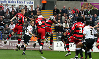 Pictured: Darren Pratley (centre) of Swansea City in action <br />
