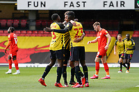 Joao Pedro (10) of Watford (centre) celebrates with Jeremy Ngakia (3) of Watford (left) and Ismaila Sarr (23) of Watford after he scores the opening goal during the Sky Bet Championship match between Watford and Luton Town at Vicarage Road, Watford, England on 26 September 2020. Photo by David Horn.