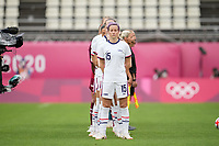 KASHIMA, JAPAN - JULY 27: Megan Rapinoe #15 of the United States stands at attention during the national anthem before a game between Australia and USWNT at Ibaraki Kashima Stadium on July 27, 2021 in Kashima, Japan.
