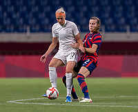SAITAMA, JAPAN - JULY 24: Hannah Wilkinson #17 of New Zealand is defended by Tierna Davidson #12 of the USWNT during a game between New Zealand and USWNT at Saitama Stadium on July 24, 2021 in Saitama, Japan.