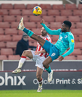 2nd January 2021; Bet365 Stadium, Stoke, Staffordshire, England; English Football League Championship Football, Stoke City versus Bournemouth; Jefferson Lerma of Bournemouth makes an overhead kick in front of Joe Allen of Stoke City to clear the danger