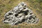 Wisley Church. Diamond shaped Sarsen stone outside positioned immediately to left of church porch. Surrey UK