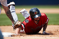 Blake Swihart (1) of the Rochester Red Wings dives back into first base during the game against the Scranton/Wilkes-Barre RailRiders at PNC Field on July 25, 2021 in Moosic, Pennsylvania. (Brian Westerholt/Four Seam Images)