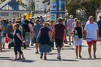 BNPS.co.uk (01202 558833)<br /> Pic: Graham Hunt/BNPS<br /> Date: 7th September 2021.<br /> <br /> Sunbathers flock to the beach to enjoy the scorching hot sunshine at the seaside resort of Weymouth in Dorset.