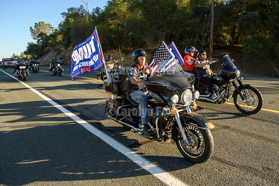 """An impromptu Trump Drive that hit social media a few days ago and expecting maybe 30 vehicle, nuked into a community-wide full-fledged, loaded with freight Trump Train traveled the roads of Amador County with more than 400 cars, trucks, motorhomes, boat trailers and more between Scottsville, to Sutter Creek. The estimated length of three to four miles took nearly two hours to settled down. Despite the massive rally traffic, few delays to locals and visitors occurred due to the peaceful and respectful drivers and the assistance of local law enforcement, Amador County SO, and CHP units who helped to keep the traffic flowing. At the conclusion of the """"train"""" many gathered to the overflow crowds to enjoy Taco Tuesday at Mel's in downtown Jackson."""