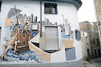 Orgosolo, Nuoro, 2 Gennaio 2018<br /> Siamo tutti clandestini.<br /> Il piccolo centro della Barbagia famoso per i dipinti che adornano le vecchie case del centro storico,e gli edifici di nuova costruzione, piazze e muri del paese. I Murales di Orgosolo narrano di storia, di politica, di vita quotidiana, e di tradizione e di Sardegna.