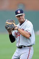 First baseman Tanner Krietemeier (49) of the Rome Braves warms up before a game against the Greenville Drive on Thursday, July 31, 2014, at Fluor Field at the West End in Greenville, South Carolina. Rome won the rain-shortened game, 4-1. (Tom Priddy/Four Seam Images)