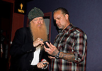 Aug. 29, 2013; Avon, IN, USA: ZZ Top guitarist/vocalist Billy Gibbons (left) exchanges cell phone numbers with Jesse James during the premiere of Snake & Mongoo$e at the Regal Shiloh Crossing Stadium 18. Mandatory Credit: Mark J. Rebilas-