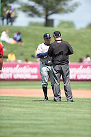 ***Temporary Unedited Reference File***Northwest Arkansas Naturals manager Vance Wilson (13) umpire Cody Oakes during a game against the Springfield Cardinals on April 27, 2016 at Hammons Field in Springfield, Missouri.  Springfield defeated Northwest Arkansas 8-1.  (Mike Janes/Four Seam Images)