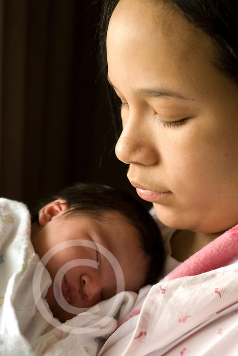 newborn baby girl 1 day old in hospital held by mother, age 19