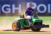 High Point Panthers associate head coach Bryan Peters drags the infield prior to the game against the Dayton Flyers at Willard Stadium on February 26, 2012 in High Point, North Carolina.    (Brian Westerholt / Four Seam Images)
