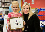 WATERTOWN, CT-121817JS02---Nora Stentiford, a kindergarten student at John Trumbull Primary School in Watertown, was presented with a framed copy of her winning holiday card by Watertown Public Schools Superintendent Dr. Bridget Carnemolla during a small ceremony Monday at the school. The card was the one choses for the 3ed annual holiday card contest, and will be sent out as this years district holiday card. <br /> Jim Shannon Republican-American
