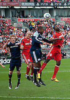 22 May 2010: New England Revolution defender Corey Gibbs #12 and Toronto FC forward O'Brian White #17 jump for a ball that is eventually headed into the net by Toronto FC forward Chad Barrett #19 for the games only goal during a game between the New England Revolution and Toronto FC at BMO Field in Toronto..Toronto FC won 1-0.....