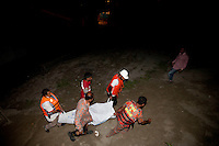 Bangladeshi rescue workers carry the dead body of one of the victims after a river ferry carrying more than 100 passengers capsized in the River Padma Sunday after being hit by a cargo vessel at Paturia , in Manikganj district, about 80 kilometers  northwest of Dhaka, Bangladesh. Feb. 22, 2015. It is yet not clear how many people are missing.