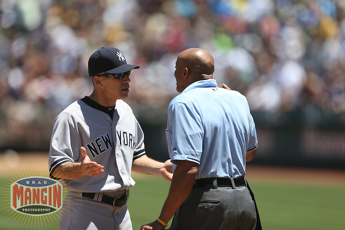 OAKLAND, CA - JUNE 13:  Manager Joe Girardi #28 of the New York Yankees argues with home plate umpire CB Bucknor during the game against the Oakland Athletics at O.co Coliseum on Thursday June 13, 2013 in Oakland, California. Photo by Brad Mangin