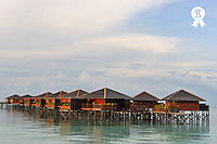 Wooden water bungalows (Licence this image exclusively with Getty: http://www.gettyimages.com/detail/88288868 )