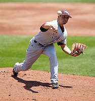 Cody Schumacher (21) of the Missouri State Bears delivers a pitch during a game against the Wichita State Shockers in the 2012 Missouri Valley Conference Championship Tournament at Hammons Field on May 23, 2012 in Springfield, Missouri. (David Welker/Four Seam Images).