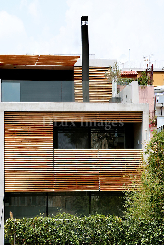 Tasos Sotiropoulos, one of three architects who made up the ISV company, resides in a three storey residence in Athens. The expressive means used by Mr. Sotiropoulos for the construction of the house are very specific: concrete, black marble, black sheet metal, industrial flooring, wood, glass, bamboo and water.