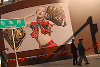 Louis Vuitton advertsies the opening of a new outlet in the western Chinese city of Kunming in Yunnan Province, China. LV is expanding agressively all over asia and sees China as a major growth market..
