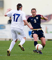 USWNT captain (3) Christie Rampone passes around Iceland's (17) Rakel Honnudottir during the Algarve Cup.  The USWNT defeated Iceland, 1-0, at Ferreiras, Portugal.