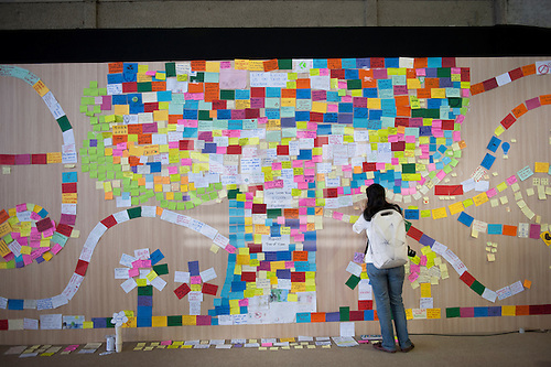 A student adds her contribution to the Tree Of Life in the main pavilin at the Riocentro. The United Nations Conference on Sustainable Development (Rio+20), Rio de Janeiro, Brazil, 20th June 2012. Photo © Sue Cunningham.