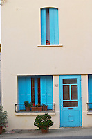 Village house with blue door and window shutters. Caramany, Ariege, Roussillon, France