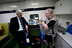 Tranmere Rovers 2  Port Vale 0, 20/03/2019. Prenton Park, League One. Club physiotherapist Les Parry chatting to the club doctor in the dressing room at Prenton Park, home of Tranmere Rovers, as his team prepare to face Port Vale in a English League One fixture. Les Parry has been the club physiotherapist since 1993 and recently completed 800 games with the club. At the time he was also working on completing his PhD at Liverpool John Moores University.Photo by Colin McPherson.