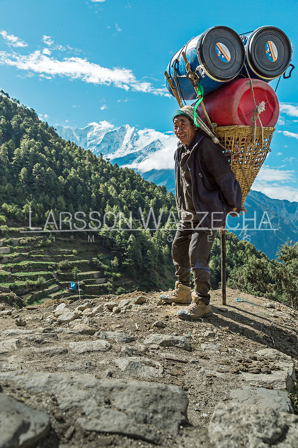 Portrait of  Sonam Sherpa, 42 years old from Phaflu region - carrying expedition equipment from Everest Basecamp to Lukla and then to Kathmandu, seven (7) days journey which will earn them a double payment for carrying double load. Khumbu, Nepal
