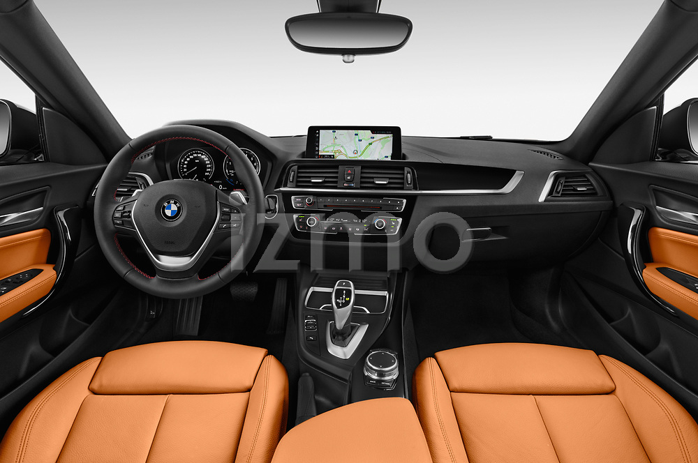 Stock photo of straight dashboard view of a 2018 BMW 2 Series Sport 2 Door Coupe
