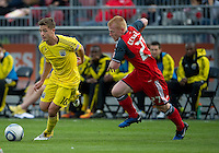 23 April 2011: Columbus Crew midfielder/forward Robbie Rogers #18 and Toronto FC defender Richard Eckersley #27 in action during a game between the Columbus Crew and the Toronto FC at BMO Field in Toronto, Ontario Canada..The game ended in a 1-1 draw.