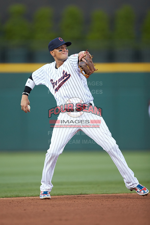 Charlotte Hornets shortstop Ryan Goins (1) makes a throw to first base against the Louisville Bats at BB&T BallPark on June 22, 2019 in Charlotte, North Carolina. The Hornets defeated the Bats 7-6. (Brian Westerholt/Four Seam Images)