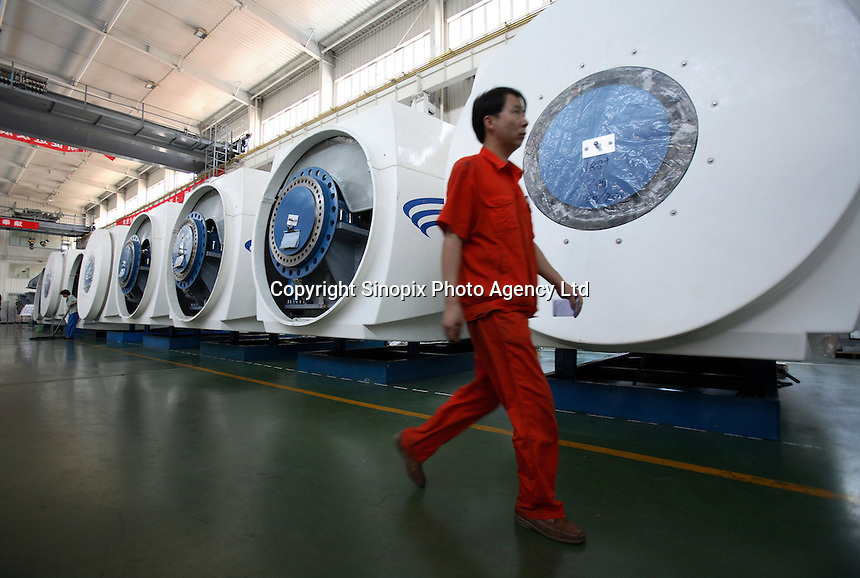 Workers assemble wind turbines at the Glodwind Science & Technology Co., LTD  in Urumqi, Xinjiang Uighur Autonomous Region, China. Goldwind is the largest maker of power generating wind turbines in China..