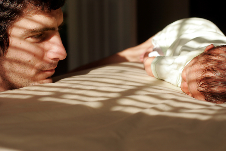My husband watches our first-born child, sleep on our bed. My son was five days old and my husband was almost 29.