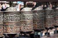 Kathmandu, Nepal.  Buddhist Prayer Wheels at Base of Stairs Leading to Swayambhunath Temple.