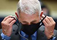 Director of the National Institute for Allergy and Infectious Diseases Dr. Anthony Fauci takes off his face before he testifies before the House Committee on Energy and Commerce on the Trump Administration's Response to the COVID-19 Pandemic, on Capitol Hill in Washington, DC on Tuesday, June 23, 2020.   <br /> Credit: Kevin Dietsch / Pool via CNP/AdMedia