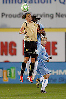 Christine Sinclair (12) of FC Gold Pride and Anita Asante (5) of Sky Blue FC go for a header. Sky Blue FC and FC Gold Pride played to a 1-1 tie during a Women's Professional Soccer match at TD Bank Ballpark in Bridgewater, NJ, on April 11, 2009.